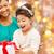 izgatott · lány · ajándék · doboz · örömteli · ül · ágy - stock fotó © dolgachov