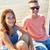 happy teenage couple with earphones on river berth stock photo © dolgachov