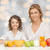happy mother and daughter eating breakfast stock photo © dolgachov