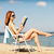 feliz · mulher · leitura · livro · salão · cadeira - foto stock © dolgachov