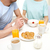 close up of couple having breakfast at home stock photo © dolgachov
