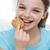 sorridere · bambina · mangiare · cookie · biscotto · persone - foto d'archivio © dolgachov