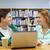 gelukkig · studenten · met · behulp · van · laptop · tabel · praten - stockfoto © dolgachov