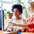 boldog · afrikai · nő · számítógéppel · iroda · üzlet · startup - stock fotó © dolgachov