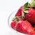 close up of ripe red strawberries over white stock photo © dolgachov