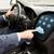 close up of man driving car with menu on computer stock photo © dolgachov