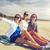 femme · séance · plage · brunette - photo stock © dolgachov