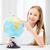 student girl with globe at school stock photo © dolgachov