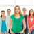 smiling students with teenage girl in front stock photo © dolgachov