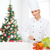 smiling female chef chopping vegetables stock photo © dolgachov