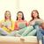 jóvenes · bastante · ninas · sesión · sofá · viendo - foto stock © dolgachov
