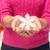 close up of woman holding snowflake decoration stock photo © dolgachov