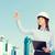glimlachend · zakenvrouw · helm · gebouw · ontwikkelen - stockfoto © dolgachov