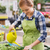 lány · locsolókanna · mosolyog · tinilány · zöld · fű · égbolt - stock fotó © dolgachov