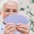close up of happy senior woman playing cards stock photo © dolgachov