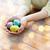 vrouw · handen · gekleurd · paaseieren · Pasen - stockfoto © dolgachov