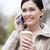felice · donna · bere · caffè · cellulare · parco - foto d'archivio © dolgachov