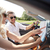 happy man and woman with map in cabriolet car stock photo © dolgachov