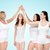 group of happy different women making high five stock photo © dolgachov