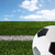 close up of football or soccer ball over white stock photo © dolgachov