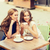 young women drinking coffee and talking at cafe stock photo © dolgachov