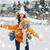 happy couple having fun over winter background stock photo © dolgachov