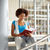 african student girl reading book at library stock photo © dolgachov