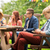 man with smartphone and friends at summer party stock photo © dolgachov