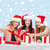 smiling women in santa helper hats with gift boxes stock photo © dolgachov