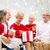 smiling family with gifts at home stock photo © dolgachov