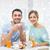 smiling couple having breakfast at home stock photo © dolgachov