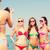 group of smiling women photographing on beach stock photo © dolgachov