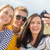 group of friends taking selfie with cell phone stock photo © dolgachov