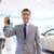 happy man showing key at auto show or car salon stock photo © dolgachov