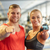 happy man and woman pointing finger to you in gym stock photo © dolgachov