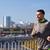 gelukkig · jonge · man · lopen · stad · brug · fitness - stockfoto © dolgachov