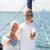 senior couple sailing on sea boat or yacht stock photo © dolgachov