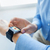 close up of hands with navigator on smart watch stock photo © dolgachov