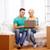 couple relaxing on sofa with laptop in new home stock photo © dolgachov