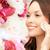 glimlachende · vrouw · schoonmaken · gezicht · huid · katoen · schoonheid - stockfoto © dolgachov