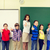 group of school kids and teacher showing thumbs up stock photo © dolgachov