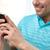 boldog · fickó · mobiltelefon · otthon · ül · nappali - stock fotó © dolgachov