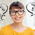 happy asian woman in glasses over question marks stock photo © dolgachov
