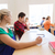 group of students writing school test stock photo © dolgachov