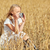 woman taking picture with camera in cereal field stock photo © dolgachov