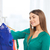 happy woman choosing clothes at home wardrobe stock photo © dolgachov