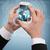 zakenman · tonen · smartphone · wereldbol · hologram · business - stockfoto © dolgachov