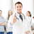 doctor with stethoscope showing thumbs up stock photo © dolgachov