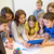 group of kids with teacher and tablet pc at school stock photo © dolgachov