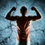 young man or bodybuilder showing biceps stock photo © dolgachov